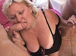 Two guys take their turns fucking this hot blonde granny