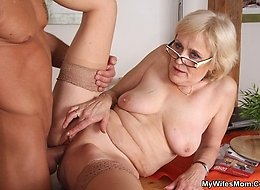 The hot mature blonde and her naughty pussy are taken by a younger, horny man