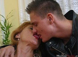 Blonde Eva gone wild when young stud kissed her deep and squeezed her tits.