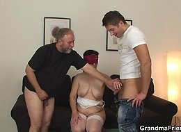 An old man and a young man give this mature brunette plenty of pleasure when they fuck her