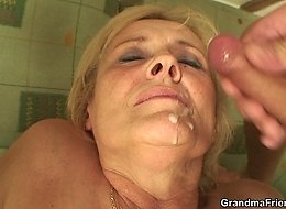 The sexy grandma has to get fucked by two young men to pay off a bet she lost